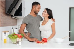 realistic expectations loving couple in kitchen