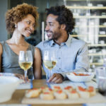 dating after divorce: couple smiling at lunch table