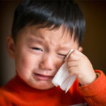 Physical & Emotional Effects of Divorce on Children: Small Asian boy crying