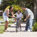 Co-Parenting Communication: co-parents teaching child to ride bike