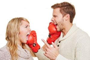 high conflict divorce: husband and wife boxing
